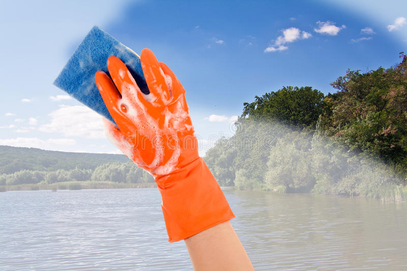 Content of the world clean. Nature's hand in a glove cleans dirt nature royalty free stock image