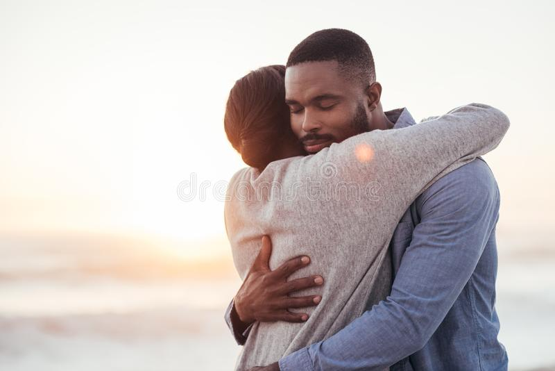 Content young African couple embracing each other at the beach stock photos
