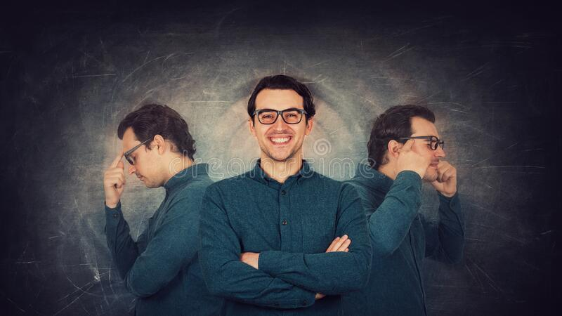 Contented man well hiding his inner personality. Guy suffers split emotions into different inner personages. Multipolar mental stock photography