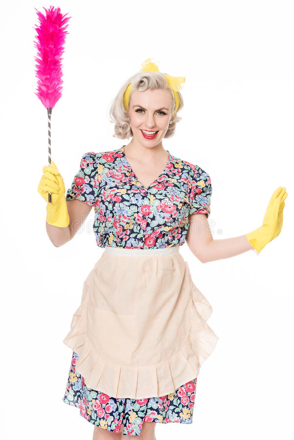 Contented retro housewife, with feather duster, isolated on white. Happy retro housewife, with feather duster, isolated on white stock photo