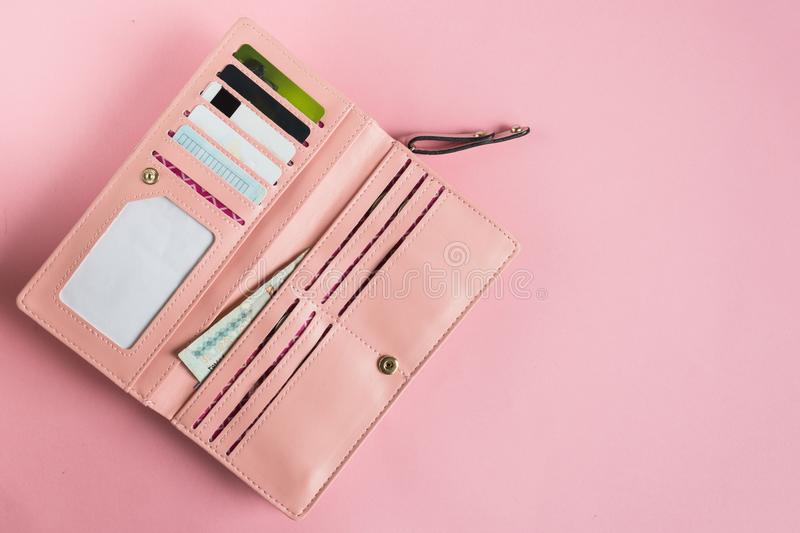Open female pink wallet. Flat lay. Copy space. royalty free stock images