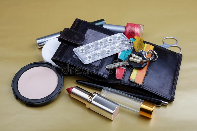 The contents of the ladies handbag  of an elderly woman stock photos