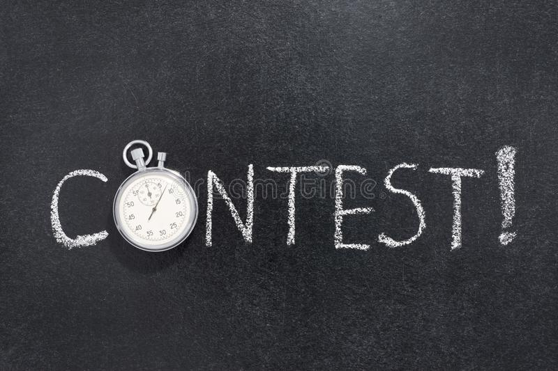 Contest word watch. Contest exclamation handwritten on chalkboard with vintage precise stopwatch used instead of O royalty free stock photo