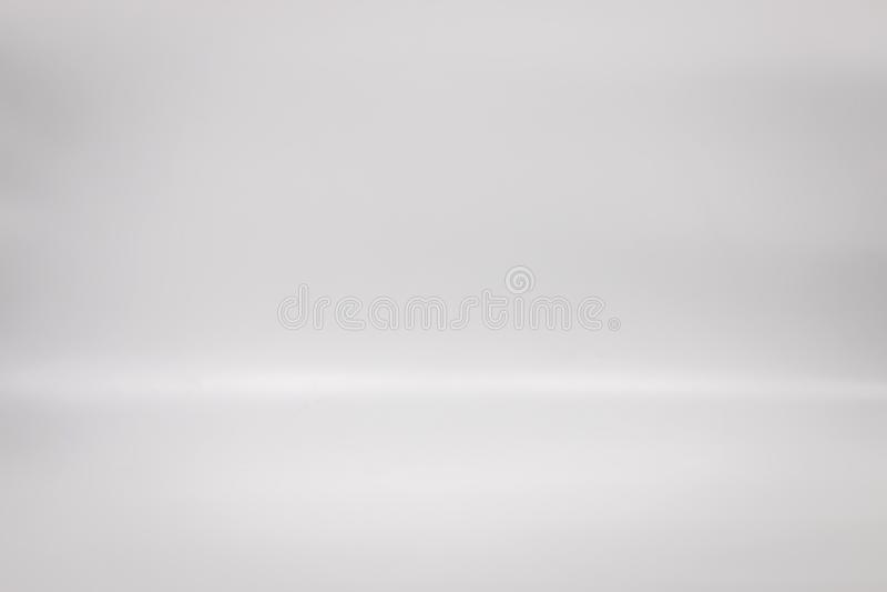Contesto bianco per il vostro prodotto Fondo del pavimento dello studio Scena grigia interna dello spazio in bianco immagine stock