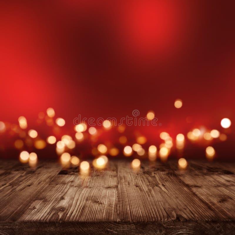 Contesto illuminato rosso con le luci dorate immagini stock