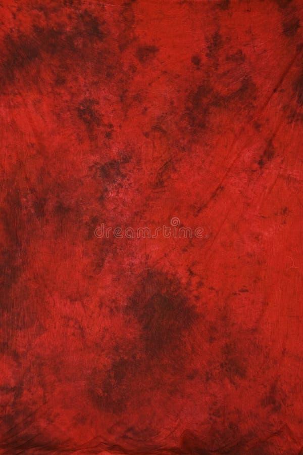 Contesto rosso di fotographia della mussola immagine stock libera da diritti