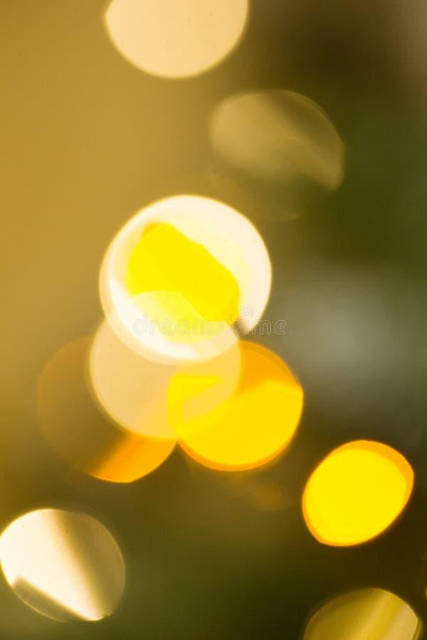 Contexto del Año Nuevo Fondo borroso con el bokeh de oro Maqueta de la Navidad o tarjeta de felicitación Fondo del día de fiesta  foto de archivo