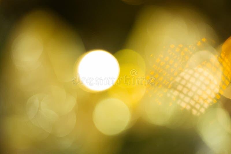 Contexto del Año Nuevo Fondo borroso con el bokeh de oro Maqueta de la Navidad o tarjeta de felicitación Fondo del día de fiesta  imagen de archivo