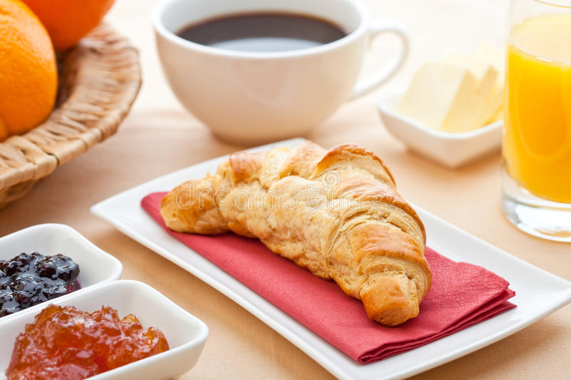 Continental breakfast. With croissant, jam, coffee and orange juice royalty free stock photos