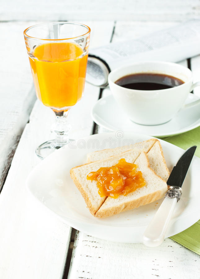 Continental breakfast - coffee, orange juice, toast stock photography