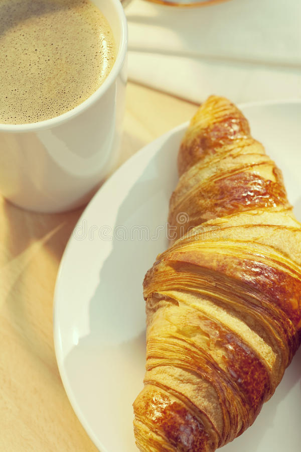 Continental Breakfast Croissant and Cup Of Coffee stock photo