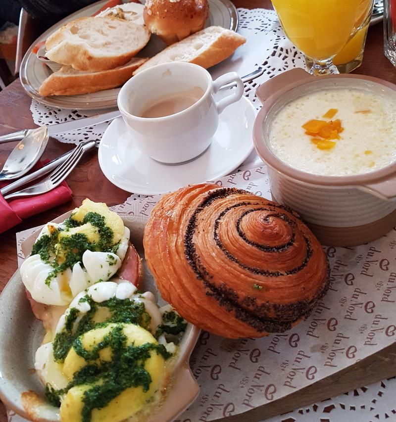 Continental breakfast or lunch: porridge, bun, egg-poached, oran royalty free stock photography
