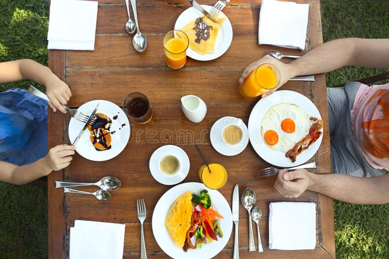 Continental breakfast with pancakes, eggs, bacon, orange jiuce and coffee. Top view royalty free stock photos