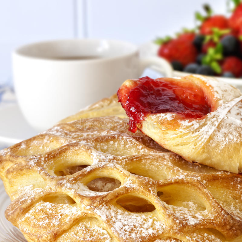Continental Breakfast. With pastries, berry fruits and coffee stock photo