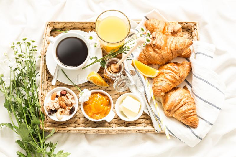 Continental breakfast on white bed sheets - flat lay royalty free stock images