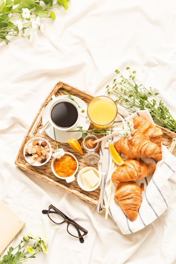 Continental breakfast on white bed sheets - flat lay royalty free stock photos