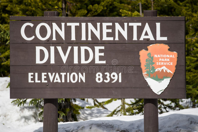 Continental divide sign on mountain in snow - Yellowstone Nation stock images