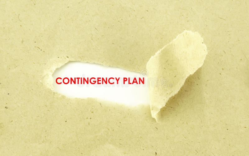 CONTINGENCY PLAN. Text CONTINGENCY PLAN appearing behind torn light brown envelop stock photo