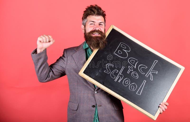 Continue a escola privada da educação O professor começa a primeira lição após feriados Escola e conceito do estudo Professor ou fotos de stock royalty free