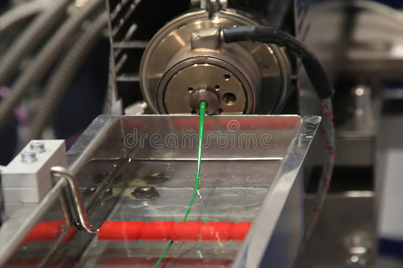 Continuous extrusion of plastic filament. Plastic Wire Filament, the Modern printing technology. Continuous extrusion with cooling in water stock photography