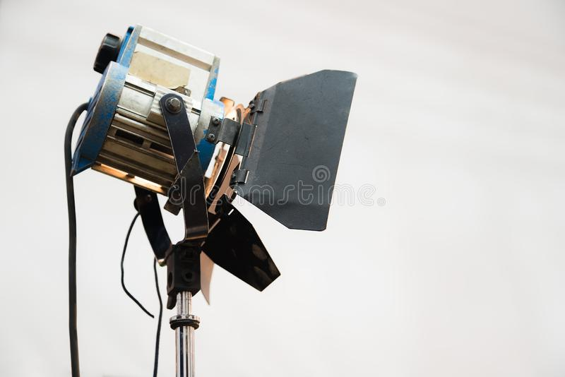 Continuous light source on studio set. Electric spotlight lamp. Continuous light source on studio set. Film industry equipment, electric spotlight lamp stock photography