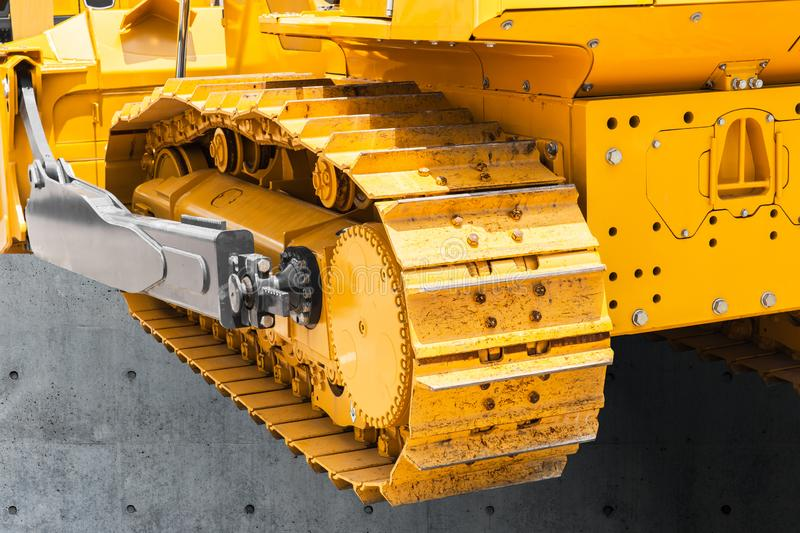 Continuous track tank tread or chains wheels excavator royalty free stock photography