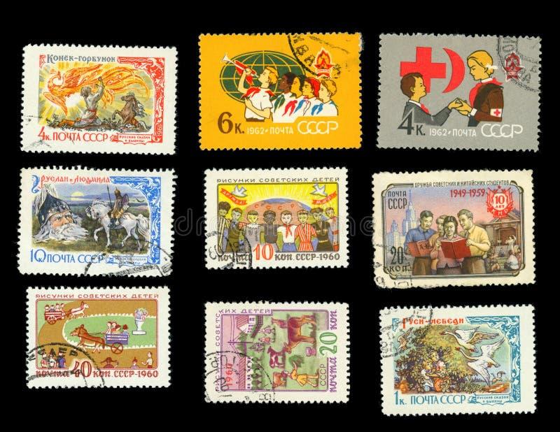 Contos de fadas do ` s das crianças e desenhos - um grupo de selos postais imagens de stock