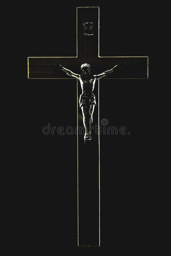The contour of the crucifix on a black background. The contour of an illuminated crucifix on a black background royalty free stock image