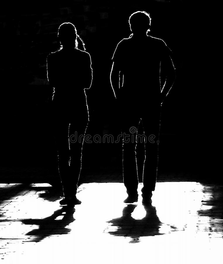 Silhouettes on a dark background stock photography