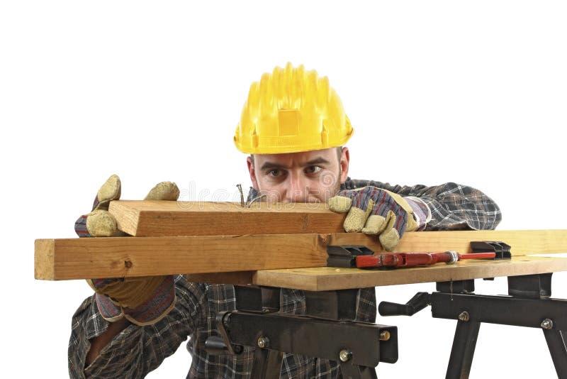 Contrôle d'ouvrier manuel sien travail photos stock