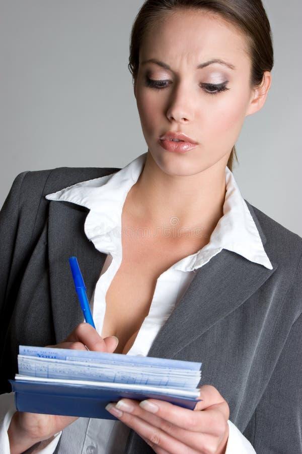 contrôle l'écriture de femme photo libre de droits