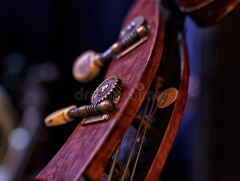 Contrabass closeup Neck of contrabass Image headstock. Contrabass, scroll and tuning keys of a contrabass royalty free stock images