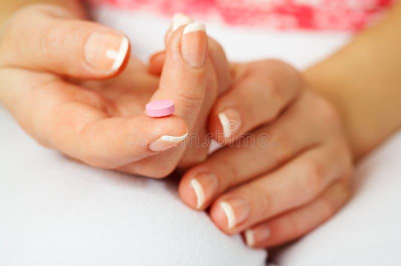Contraceptivo cor-de-rosa foto de stock royalty free