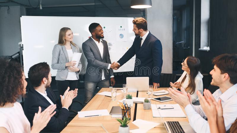 Contract conclusion. Business partners shaking hands in office royalty free stock images