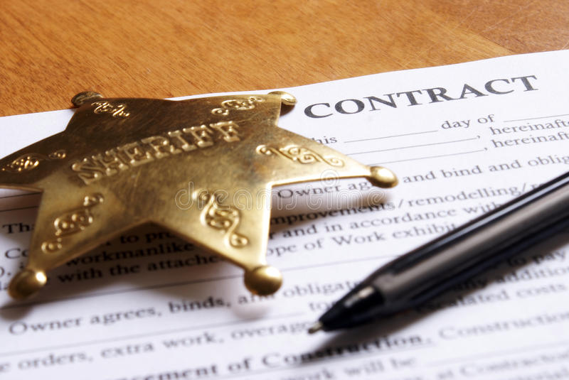 Contract Deal Signing. Closeup view of a new contract deal arranged on the desktop with a pen for writing and signing royalty free stock images