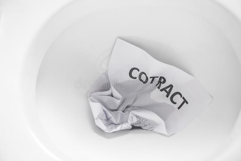 Contract flush away. Document of contract flush away royalty free stock image