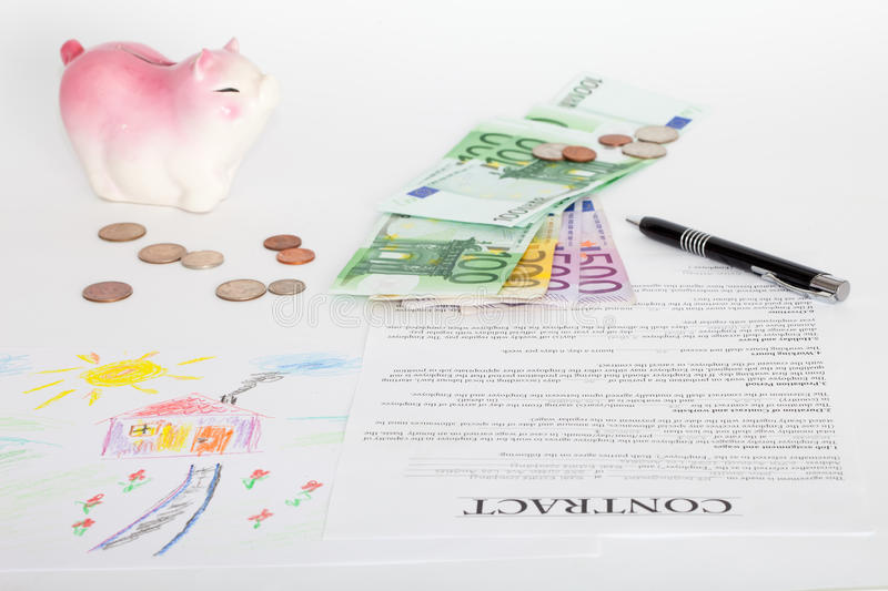 Contract of house sale or mortgage papers. With a piggy and money on the document. Suitable for real estate concept royalty free stock photo