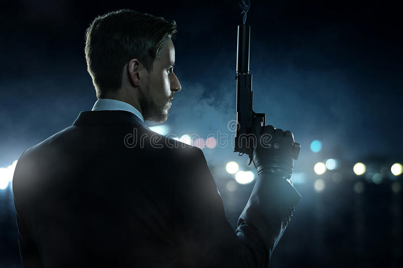 Contract Killer. With his weapan stock photography