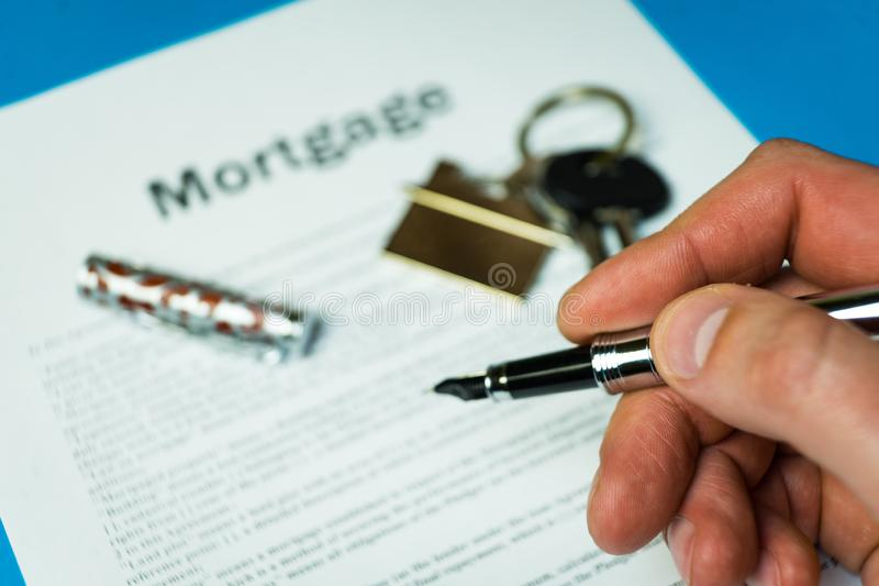The contract for a mortgage loan. The keys of the property stock photo