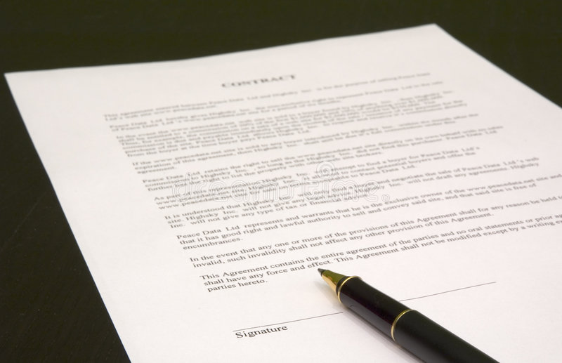 Contract and pen. Image of contract to be signed stock photo