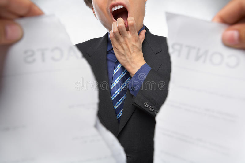 Contract refusal or rejection. Businessman gawk and shocked when the contract being torn out stock photography