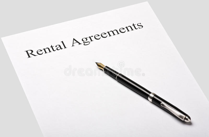 Contract rental agreement. Is isolated on a gray background royalty free stock photo
