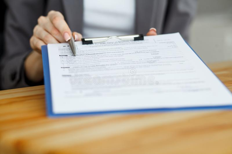 Contract waiting for a notary public sign on desk stock image