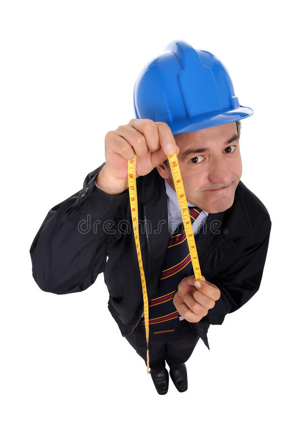 Contractor. A contractor with a measuring tape, isolated on a white background royalty free stock photography