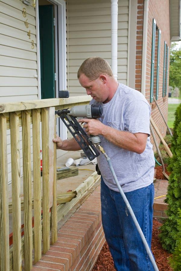 Contractor building porch rail royalty free stock photos