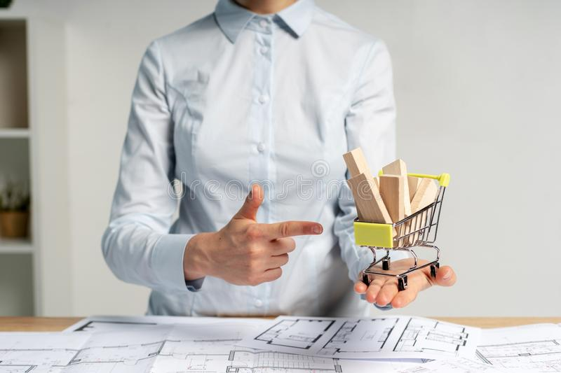 Contractor businesswoman or manager lady in her formalwear stand indoor workplace office. She make advice indicate by forefinger royalty free stock image
