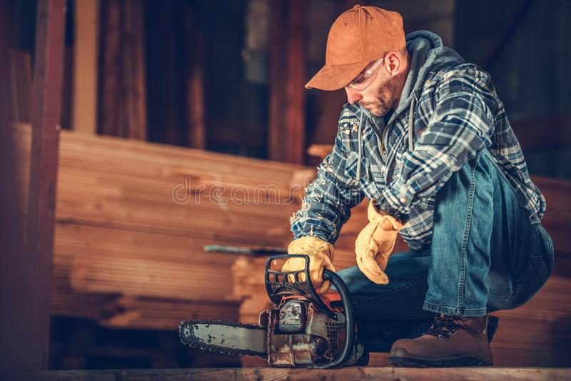 Contractor with a Chainsaw stock image
