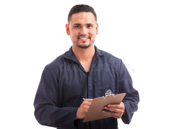 Contractor doing a home inspection. Portrait of a young handsome contractor going through a home inspection on a white background stock photo