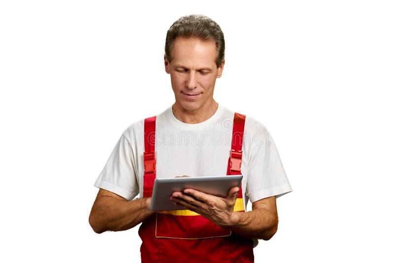 Contractor engineer man using digital tablet. stock photo
