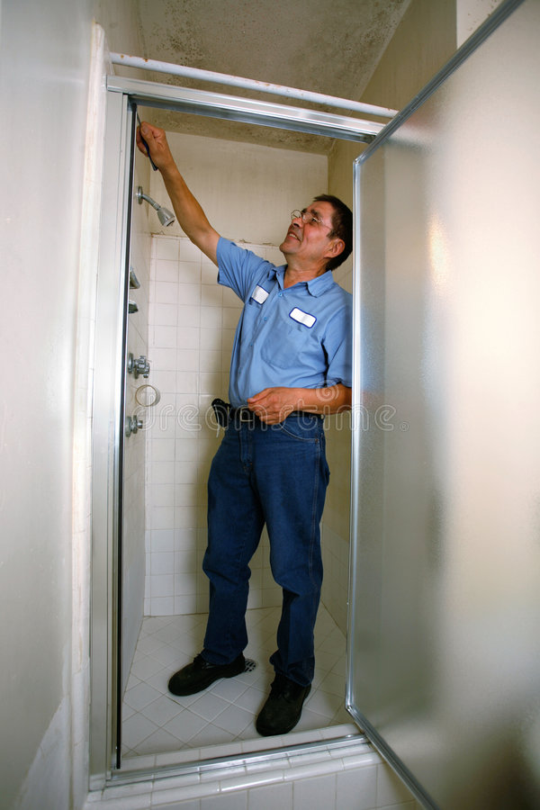 Contractor fixing shower royalty free stock photography